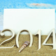 New year 2014 card on the beach — Stock Photo