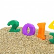 Multicolored new year 2014 on the sand — Stock Photo #22267373