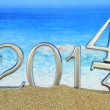 Stock Photo: New year 2014 on the beach