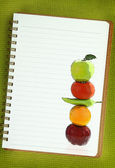 Fruits and vegetables painting on blank notebook page — Stock Photo
