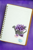 Easter eggs and saffron flowers painting on blank notebook page — Stock Photo