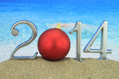 New year 2014 with Christmas ball on the beach — Stock Photo