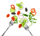 Fresh mixed vegetables and silver forks isolated on white — Stock Photo