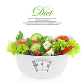 Diet meal. Vegetables salad in a bowl with weight scale — Photo