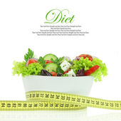 Diet meal. Vegetables salad in a bowl with measuring tape — Stockfoto