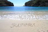 Summer written on sandy beach — Stock Photo