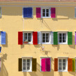 Stock Photo: Colorful windows with louvered shutters