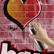 Heart graffiti on red brick wall - Stock Photo