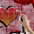 Heart graffiti on red brick wall — Stock Photo