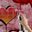 Stock Photo: Heart graffiti on red brick wall