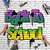 Back to school graffiti on brick wall — Stock Photo