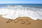 Boss, written on golden sandy beach — Stock Photo