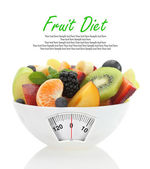 Diet meal. Fruit salad in a bowl with weight scale — Stock Photo