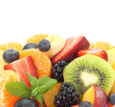 Close up of fresh mixed fruit salad — Stock Photo