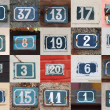 Collage of weathered house numbers on the wall — Stock Photo #24728423