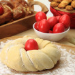 Easter sweet bread dough with red eggs — Stock Photo #25311309