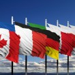 Flags of G8 members against blue sky — Stock Photo