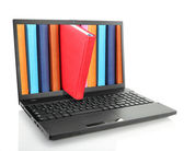 Laptop computer with colored books — Stock Photo
