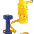 Orange juice with measuring tape and dumbbell — Stock Photo