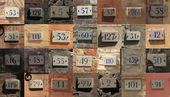 Collage of weathered house numbers in Siena, Italy — Stock Photo