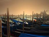 Traditional gondolas in Venice at dusk — Stock Photo