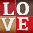 Wooden letters forming word love written on leather background — Stock Photo