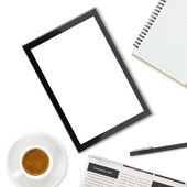 Tablet computer, coffee cup and other office supplies on white background — Stock Photo