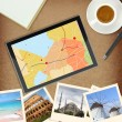 Tablet computer with gps map and photos of famous places — Stock Photo