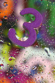 Number three on abstract colorful drops background — Stock Photo
