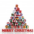 Merry Christmas everyone! Christmas tree made from gift boxes with different flags — Stock Photo