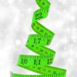 Christmas diet concept. Christmas tree made from measure tape — Stock Photo