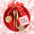 Red Christmas plate on elegance background — Stock Photo