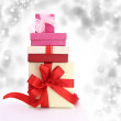 Gift boxes with lights on the background — Stok fotoğraf