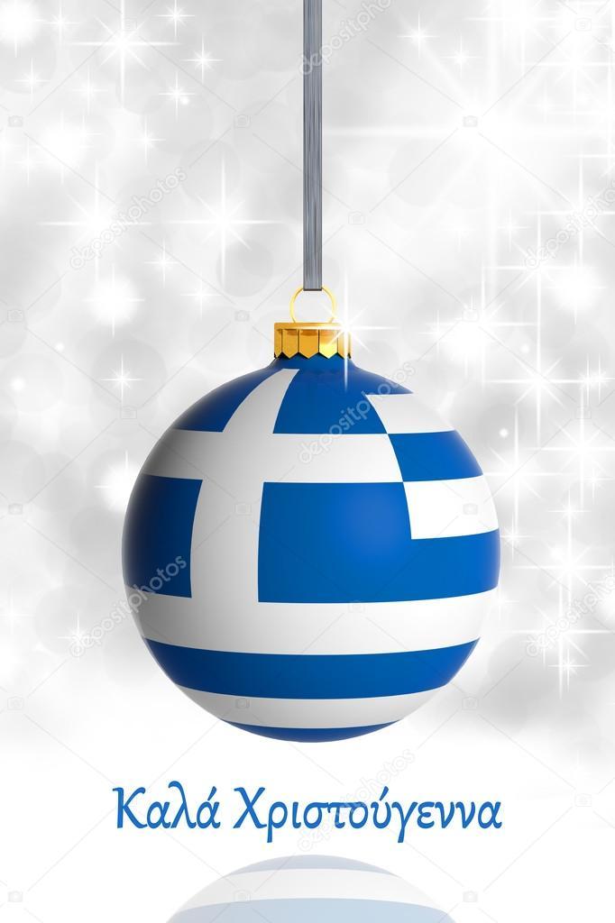 Merry christmas from greece christmas ball with flag stock photo