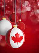 Christmas balls with Canadian flag in front of lights background — Stock Photo