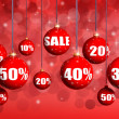 Red Christmas balls with numbers and percent symbols for Christmas sale — Stock Photo #31467795