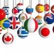 Christmas balls with different flags hanging on white background — Stock Photo