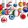 Christmas balls with different flags hanging on white background — Stock Photo #31470785