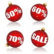 Red Christmas balls with numbers and percent symbols for Christmas sale — Stock Photo #31473659