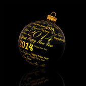 Happy new year 2014 written on Christmas ball on black background — Stock Photo