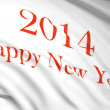 Stock Photo: Happy new year 2014 written on white waving flag with red letters