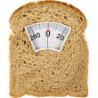 Wholesome slice of bread as weighing scale isolated on white — Stock Photo