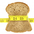 Wholesome slice of bread with measuring tape isolated on white — Stock Photo