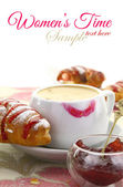Cup of coffee with lipstick mark and croissant with strawberry jam — Stock Photo