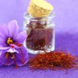 Dried saffron spice and Saffron flower — Stock Photo #34415703