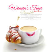Cup of coffee with lipstick mark and croissant with strawberry — Stock Photo
