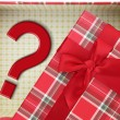 Stock Photo: Top of present box with question mark