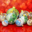Christmas balls with money texture — Stock Photo #35092845