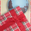 Present box with globe inside — Stock Photo