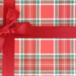 Top of present box with red ribbon — Stock Photo